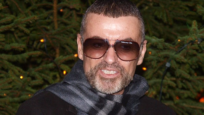 A British coroner says George Michael's death was caused by heart disease and a fatty liver.