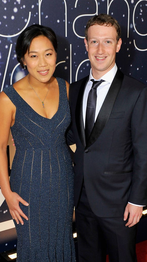Breakthrough Prize Founders Priscilla Chan and Mark Zuckerberg (R) attend the Breakthrough Prize Awards Ceremony Hosted By Seth MacFarlane at NASA Ames Research Center on November 9, 2014 in Mountain View, Calif.