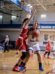 Harper Creek's Madelyn Alexander(24) goes for the hoop