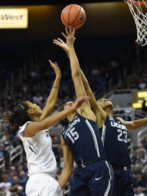Nevada's Terae Briggs battles battles for a rebound against UConn's Gabby Williams (15) and Azura Stevens last season at Lawlor Events Center.