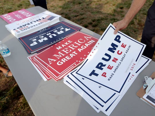 Campaign signs for Republican presidential candidate Donald Trump.