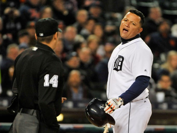 Detroit Tigers' Miguel Cabrera talks with home plate