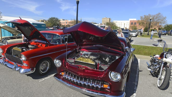 Custom cars on display during November's inaugural PensaCruise at Palafox Pier. The event will return Friday.