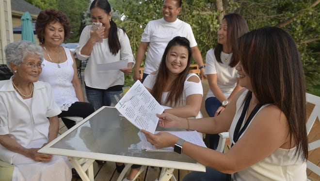 Members of Fil Am Great Falls, the newly formed Filipino-American club, hold a meeting on Monday night to finalize their upcoming event, Taste of the Philippines.