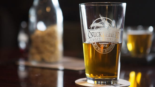A pint of beer sits on a table at the grand opening of Knucklehead Craft Brewing in Webster on Saturday.