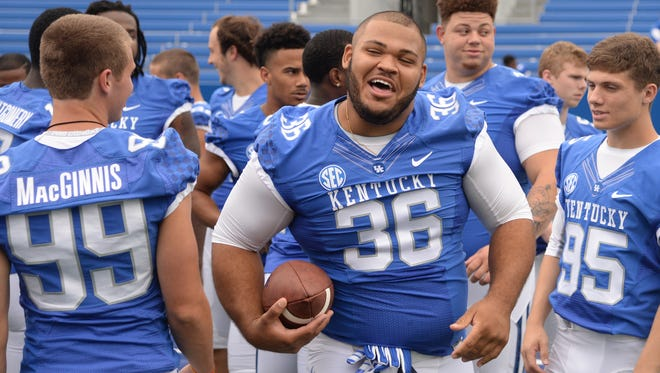 Sophomore defensive lineman Jacob Hyde jokes around during the University of Kentucky Football media day at Commonwealth Stadium in Lexington, Ky., on August 7, 2015. Photo by Mike Weaver