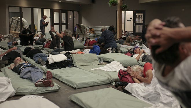 Residents rest in the men's area at the Lodestar Day Resource Center homeless shelter on Aug. 18, 2016.