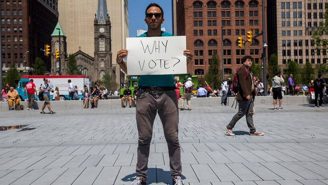 Oskar Mosco, 35, traveled from Santa Barbara, Calif., to protest in front of the Republican National Convention in Cleveland in July. Voters in 20 states including Wisconsin will face additional requirements and restrictions to vote, passed since the last presidential election in 2012, including presenting specific forms of identification at the polls.