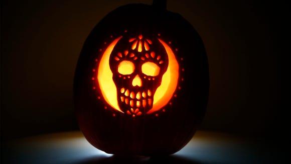 A sugar skull pumpkin carving by sports reporter Bill
