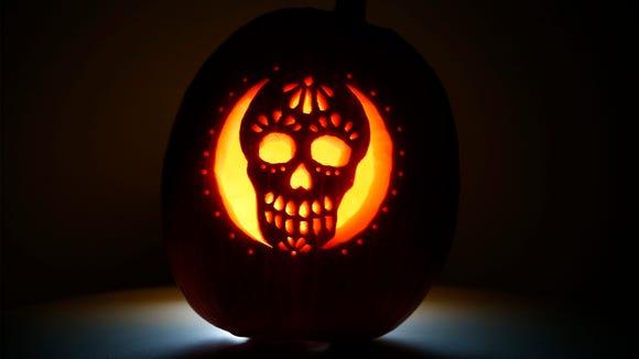 A sugar skull pumpkin carving by sports reporter Bill Knight.