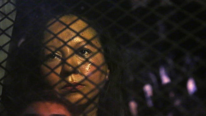 Guadalupe Garcia de Rayos was locked in a van that was stopped in the street by protesters outside the Immigration and Customs Enforcement office on Wednesday, Feb. 8, 2017, in Phoenix. Her attorney said the Mexican consulate informed him the Garcia de Rayos was deported to Nogales, Sonora, Mexico, on Thursday, Feb. 9, 2017.