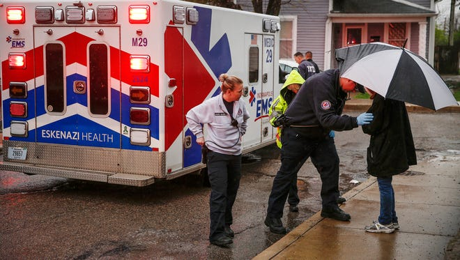 Jessica McGinn, left, district lieutenant with Indianapolis EMS, responds to a possible assault call on the south side of the city alongside EMT Ryan Marcoux and paramedic Linda Hodge-McKinney on Friday, March 31, 2017.