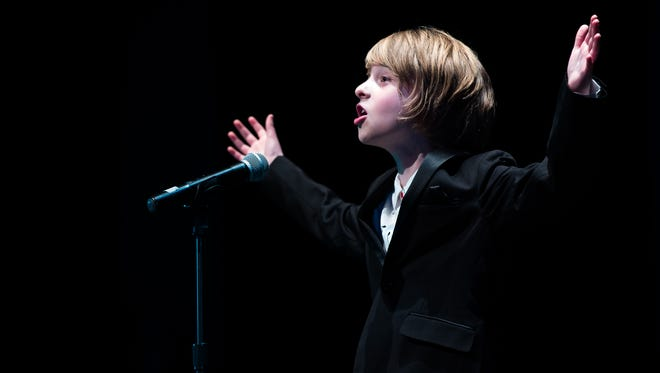 """Rowan Barber, 10, sings """"Evermore"""" during the 8th annual Hanover Has Talent Show on Saturday. Rowan won both People's Choice and first place in the competition and will donate his his prizes to a homeless shelter."""