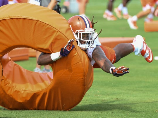 Clemson offensive lineman Jabril Robinson (50) tackles a soft object during the first preseason practice in Clemson on Thursday.