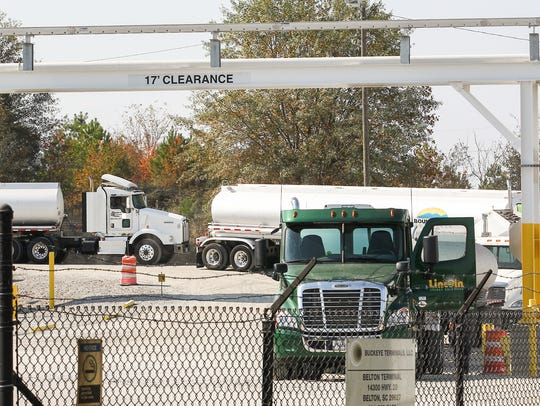 Gas tankers wait to fill up Tuesday at the Buckeye
