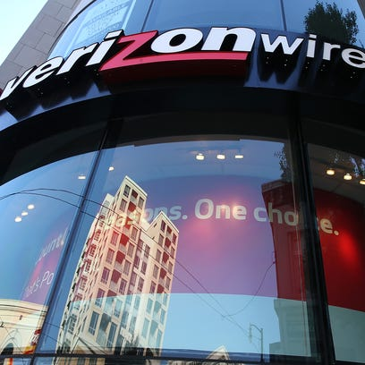 A sign is posted on the exterior of a Verizon Wireless