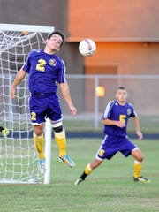 Crisfield's Ben Daum redirects the ball.