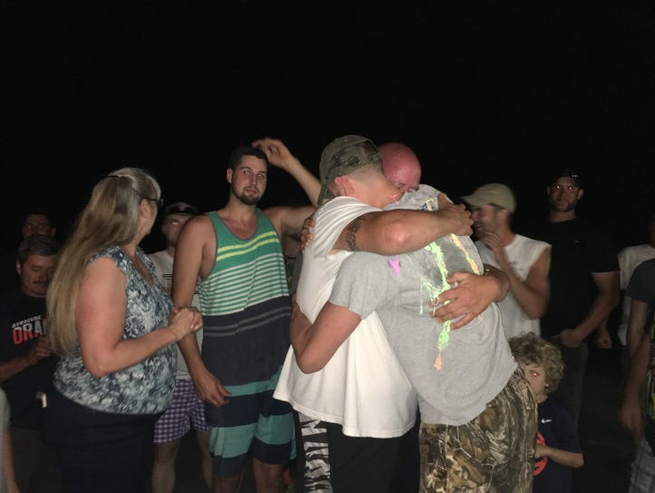 Tyler Lydon, surrounded by relatives, hugs his dad,