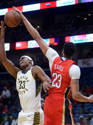 New Orleans Pelicans forward Anthony Davis (23) blocks a shot from Indiana Pacers center Myles Turner (33) during the first half of an NBA basketball game in New Orleans on Wednesday, March 21, 2018.