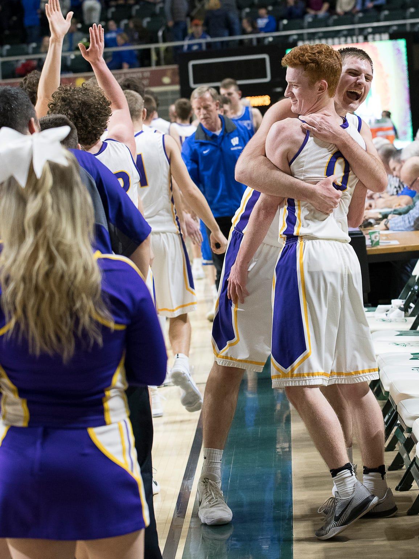 Unioto's Peyton Hill hugs teammate Logan Swackhammer