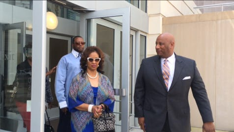 James Craig Anderson's sister, Barbara Anderson Young (center), leaves the federal courthouse today with Anderson family attorney Winston Thompson (right) and Anderson's partner James Bradfield.
