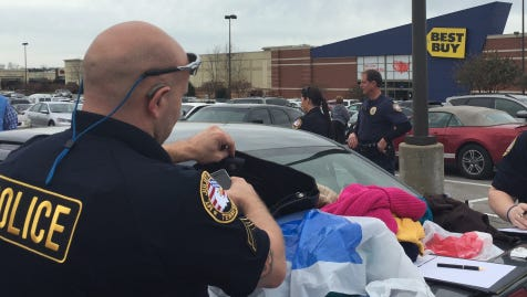 Mt. Juliet police sort through items they say were stolen Friday morning from Belk and JCPenney stores.