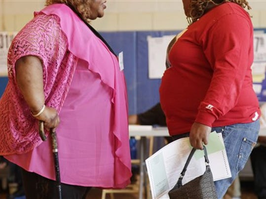 FILE- In this file photo dated Tuesday, June 26, 2012, two overweight women hold a conversation in New York, USA. Almost a third of the world population is now fat, and no country has been able to curb obesity rates in the last three decades, according to a new global analysis released Thursday May 29, 2014, led by Christopher Murray of the Institute for Health Metrics and Evaluation at the University of Washington, USA, and paid for by the Bill & Melinda Gates Foundation. Researchers reviewed more than 1,700 studies covering 188 countries covering over three decades and found more than 2 billion people worldwide classified as overweight or obese. The highest rates of obesity were found in the Middle East and North Africa, with the U.S. having about 13 percent of the world s fat population. (AP Photo/Mark Lennihan, FILE) (Mark Lennihan)