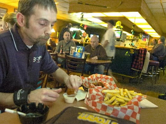 Don Harbaugh fills up on dinner at Brenn s Pub before hitting the lanes with a men s bowling league at Colony Park Lanes North in York.