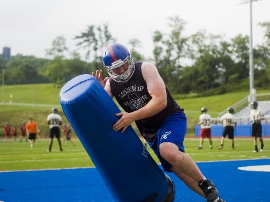 David Shaw takes on a tackling dummy during a Spring Grove 7-on-7 workout. Shaw was selected to the Big 33 Football Classic. (GAMETIMEPA.COM -- FILE)