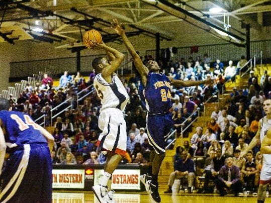 William Penn's Tavon Parker challenges a shot from South Western's Jamahn Lee during a game last Friday.