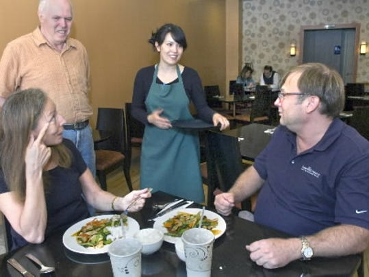 Co-owner Sam Delp and his daughter, Pam Ahrens, wait on customers in their York restaurant, which opened last month.