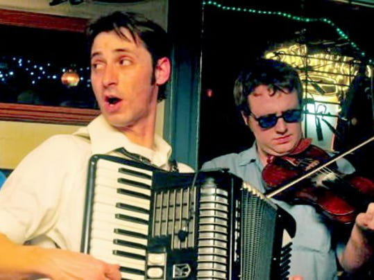 Dan Shiflet, right, and Clint Keener, left, play in Garrahan s Ghost, a local sextet that specializes in filling bars with tradition Irish tunes.