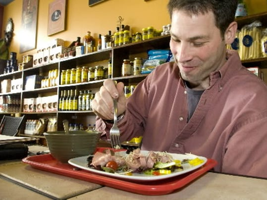 Michael McNamara stops in the Deli of Italy for lunch often. Here, he eats an antipasto salad.