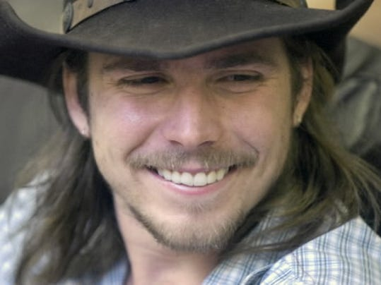 Lukas Nelson, son of Willie Nelson, smiles during Willie Nelson's Country Throwdown in May at York's Sovereign Stadium.