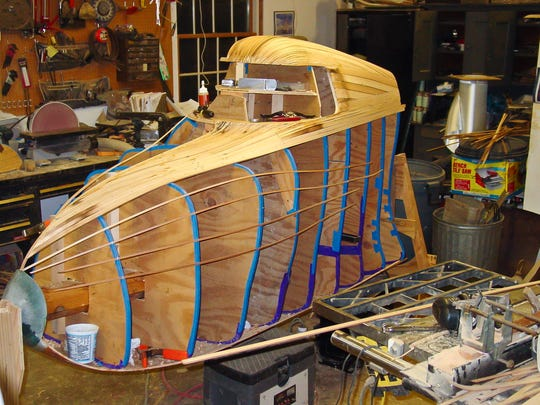 Under construction: Strips of wood give shape to plywood cross-sections on Paul Smith's ScooterCar, seen here in his garage workshop in Burlington's South End.