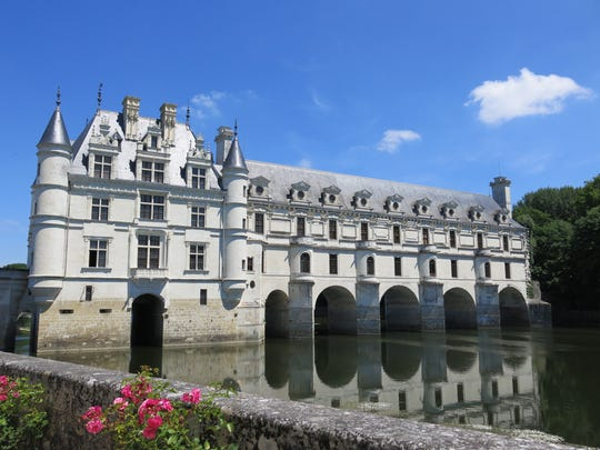 The Chateau de Chenonceau spans the River Cher near the village of Chenonceaux, France. The chateau has been refurnished, and the wing built spanning the river has been turned into a gallery.
