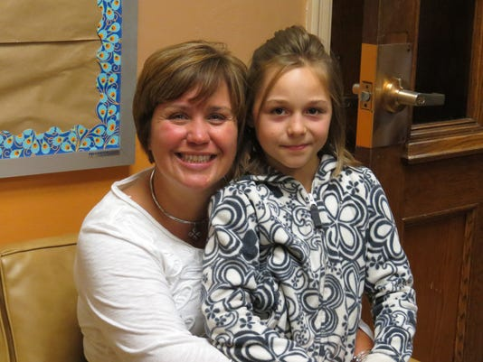 Terese Mullen and a student at SVE Elementary School.jpg