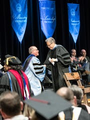 Ohio Christian University's eleventh president Dr. Jon S. Kulaga shakes the hand of special address speaker Eric Metaxas after Metaxas spoke about the importance of a Christian education.