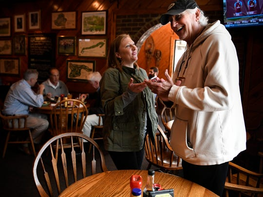 McCabe Pub owner Stefanie Dean Brown chats with customer John Haley at her restaurant Thursday, April 19, 2018, in Nashville, Tenn. Brown has a rare cancer, LAM, which stands for lymphangioleiomyomatosis. The restaurant has an annual crawfish boil to raise money for the LAM Foundation.