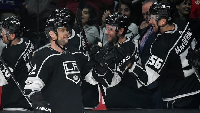 Los Angeles Kings right wing Marian Gaborik, left, celebrates with players on the bench after his goal during the third period of an NHL hockey game against the Minnesota Wild in Los Angeles, Tuesday, Dec. 5, 2017. The Kings won 5-2. (AP Photo/Kelvin Kuo)