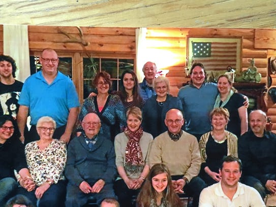 Susan Krackehl, back row, third from right, and her family celebrate Thanksgiving at her brother's log home on the Mohawk River north of Albany. For the first time in her life, this year Krackehl, 70, will be the oldest person at the family's Thanksgiving table.