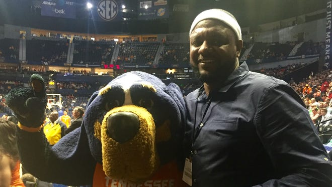 Former Vol Ron Slay wore his signature white headband when he was honored as an SEC legend during halftime of the Tennessee-Georgia game Thursday at Bridgestone Arena.