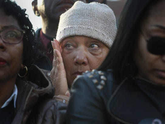 Debra Martin of Memphis wipes a tear during the tolling