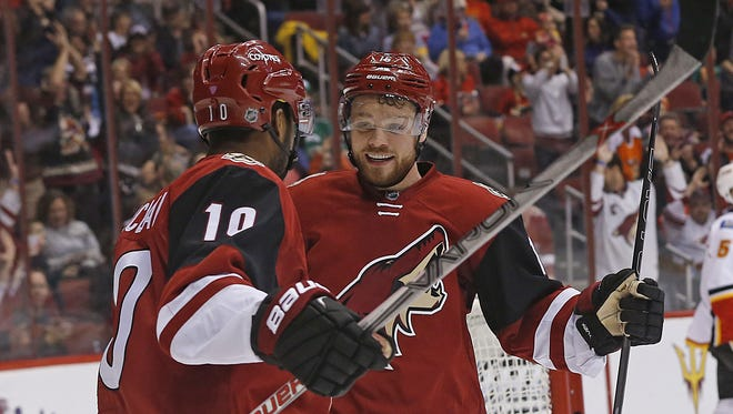 Young stars Max Domi (right) and Anthony Duclair celebrate Duclair's goal against the Calgary Flames on Feb. 12.