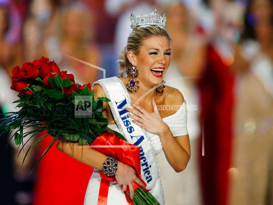 In this Jan. 12, 2013 file photo, Miss New York Mallory Hytes Hagan reacts as she is crowned Miss America 2013 in Las Vegas. Some former Miss Americas were shamed in emails from the pageant's former CEO Sam Haskell. Hagan's appearance and sexual habits were mocked in the emails. (AP Photo/Isaac Brekken, File)