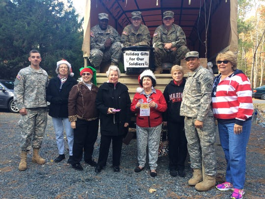 Volunteers from Star Charities posed with soldiers