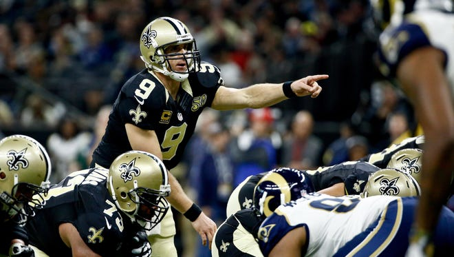 New Orleans Saints quarterback Drew Brees (9) points to the Los Angeles Rams defense during the first half of a game at the Mercedes-Benz Superdome.