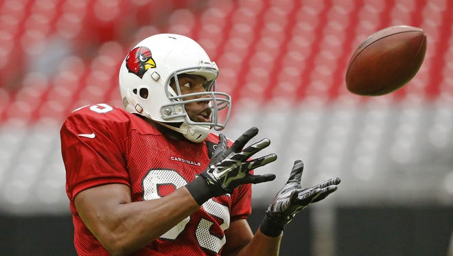 Arizona Cardinals tight end Darren Fells (85) eyes the ball during training camp Tuesday, August 11, 2015 in Glendale.