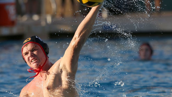 Ryan Sawyer of Palm Desert shoots against Cajon during the Aztecs 12-9 loss Tuesday at the Palm Desert High School pool. Ryan Sawyer, 10, of Palm Desert shoots against Cajon during the Aztecs loss, Tuesday, November 10, 2015.