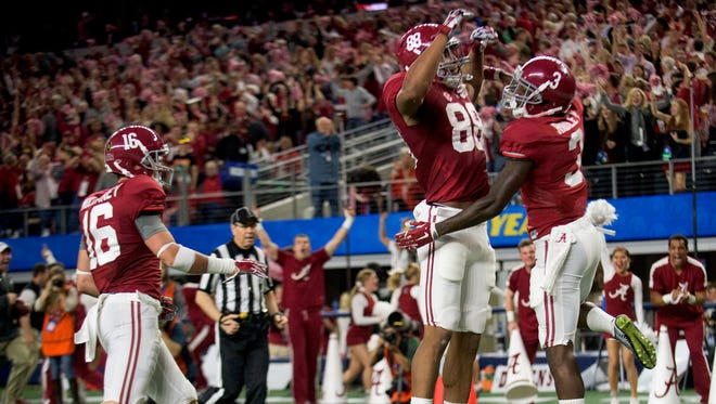 Alabama wide receiver Calvin Ridley (3) celebrates with Alabama tight end O.J. Howard (88) after scoring on a long touchdown in second half action in the Cotton Bowl on Thursday December 31, 2015 at AT&T Stadium in Arlington, Tx. (Mickey Welsh / Montgomery Advertiser)